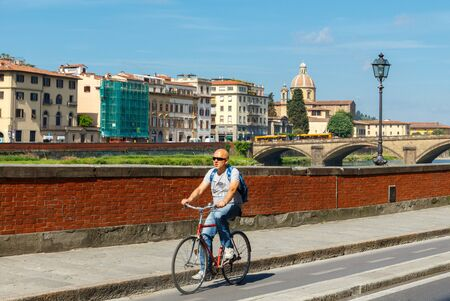 move in: Florence, Italy - May 19, 2015: People move in Florence on bicycles. The most popular and environmentally friendly transport in Italy.