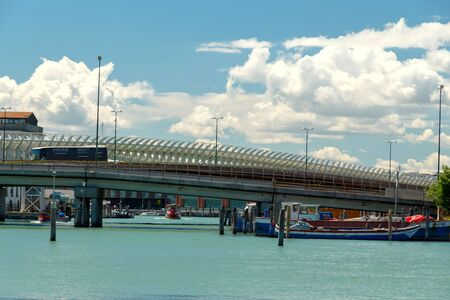 monorail: Venice, Italy - May 24, 2015: Monorail through the canal linking the city with the port. Editorial