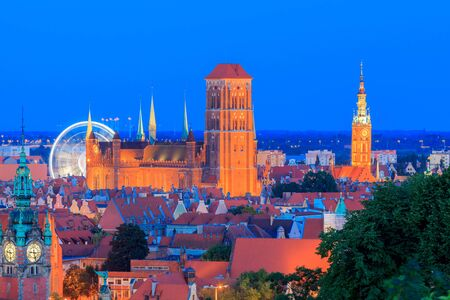 church tower: View of the historic center of Gdansk, and St. Marys Church at night.