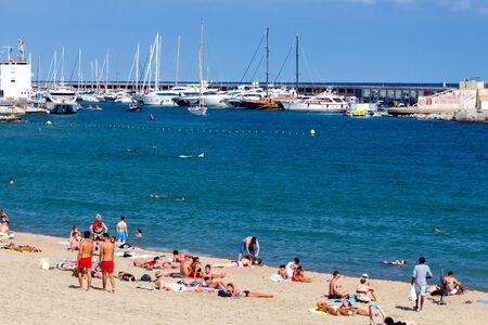 bathers: Barcelona, Spain - September 5, 2015: Barceloneta is one of the most popular city beaches of Barcelona. Many tourists come here to sunbathe, swim and play sports.