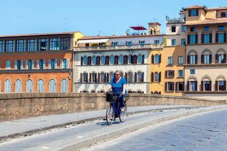 move in: Florence, Italy - May 18, 2015: People move in Florence on bicycles. The most popular and environmentally friendly transport in Italy. Editorial