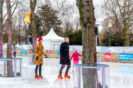 champs elysees: Paris, France - December 20, 2014: Christmas ice rink on the Champs Elysees in Paris. Tourists citizens and their children are happy to skate in the Christmas holidays.