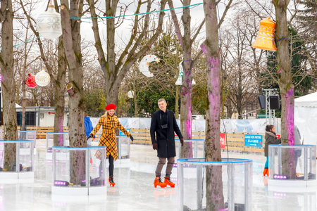 elysees: Paris, France - December 20, 2014: Christmas ice rink on the Champs Elysees in Paris. Tourists citizens and their children are happy to skate in the Christmas holidays.