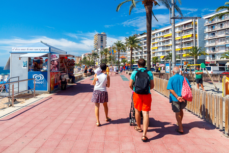 vacationers: Lloret de Mar, Spain - September 13 2015: A crowd of vacationers enjoy the warm beaches of the Costa Brava in Lloret de Mar. Lloret de Mar is one of the largest resorts on the coast of Spain.