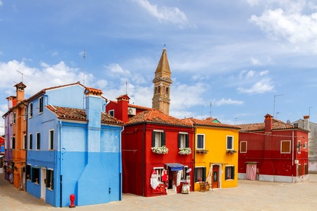color: Burano. The island in the lagoon near Venice. Famous tourist attraction. Famous for its colorful houses and lace.