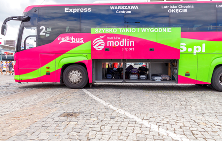 tourists stop: Warsaw, Poland - July 26, 2015: Luggage in the luggage compartment of the bus from the center of Warsaw in Airport. Editorial