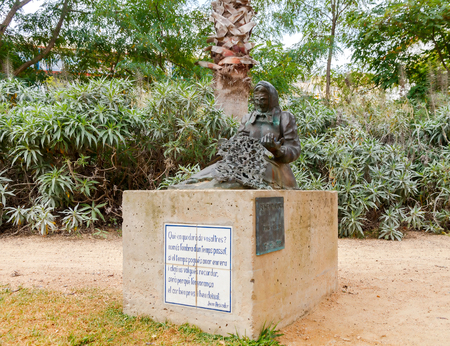 reference point: Tossa de Mar, Spain - September 10, 2015:  A bronze sculpture of a woman knitting a fishing net. Tossa de Mar, a former fishing village, now a popular resort. Editorial