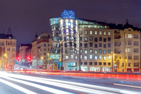 dancing house: Prague, Czech Republic - December 23, 2015: The famous dancing house on a street in Prague Resslovoy. It is one of the main tourist attractions of the city.