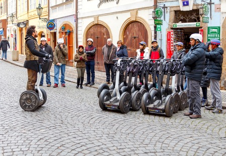 december 25: Prague, Czech Republic - December 25, 2015: Tour through the streets of old Prague on the Segway. One of the most popular tourist attractions.