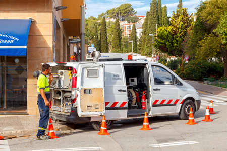 piped: Tossa de Mar, Spain - September 17, 2015: Workers feces disposal and piped services in the streets of Tossa de Mar. Costa Brava.