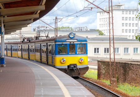railroad station platform: Passenger train at the railway station in the city of Gdynia. Stock Photo