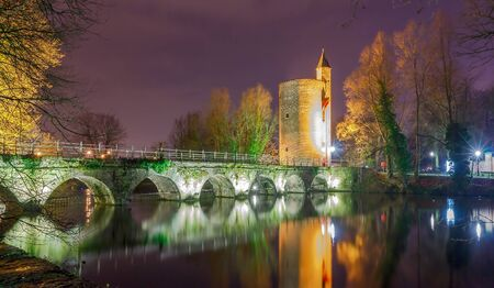 reference point: Old park Minnewater and lake in Bruges at night. One of the favorite tourist attractions.