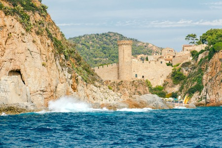 reference point: Small beach in Tossa de Mar, near the old medieval fortress.