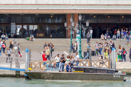mol: Venice, Italy - May 25, 2015: Landing of tourists near the central  train station Santa Lucia by water taxi in Venice.