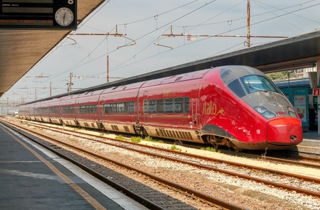means of transportation: Venice, Italy - 25 May 2015: High-speed train at the central railway station in Venice. High-speed trains are one of the most popular and comfortable means of transportation in Italy.