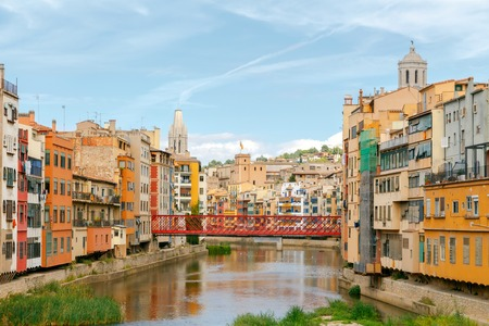 jewish houses: Yellow, red and orange facades of houses in Girona and Cathedral. Spain, Catalonia.