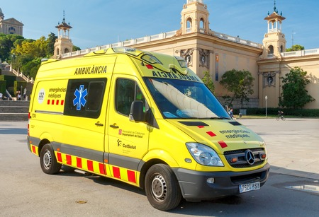 Barcelona, Spain - September 5, 2015: The crew of the ambulance are on duty at the Plaza of Spain in Barcelona.