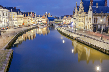 Facades of old medieval houses on the central waterfront in Ghent at night. Stock Photo