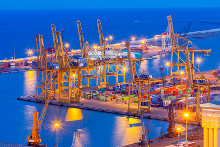 View cargo port and large cranes in Barcelona from Montjuic hill. Stock Photo