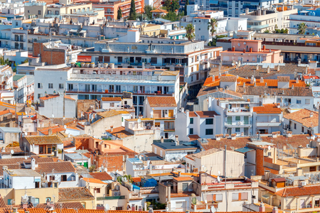 spanish houses: Roofs of houses and streets of the popular Spanish resort of Tossa de Mar, Costa Brava.