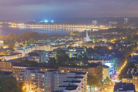 reference point: Aerial view of Tallinn from a skyscraper at night.