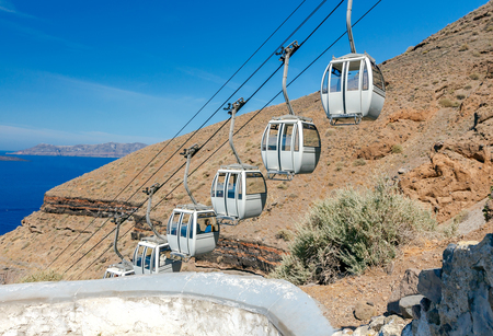 The cable car connecting the harbor and the old village Fira located on the top of rocks. Stock Photo