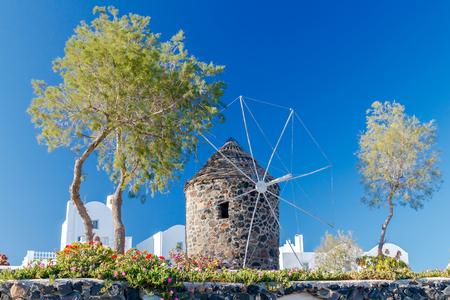 traditional windmill: Traditional windmill on the Greek island  Santorini on the background of blue sky.