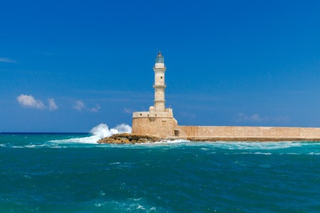 mol: Old lighthouse in Chania in stormy weather.
