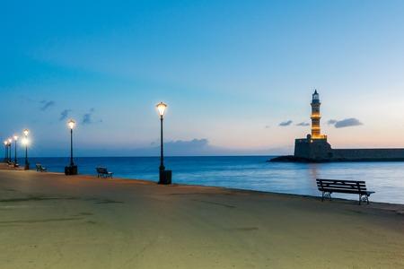 embankment: Embankment and lighthouse at sunrise.