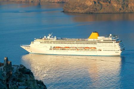 tera: Beautiful landscape with sea and passenger ship near island Nea Kameni. Santorini, Greece.