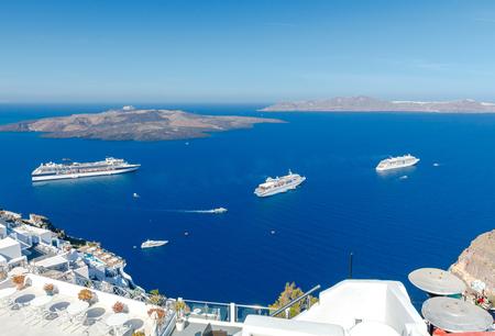 passenger ships: Passenger ships in the old port of Fira early sunny morning. Santorini. Greece. Stock Photo