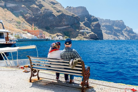 fira: Passenger ship in the old port of Fira early sunny morning. Santorini. Greece. Stock Photo