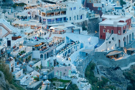 fira: View of the town Fira in the night light. Santorini. Stock Photo