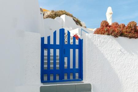 fira: Traditional narrow street in the town Fira on the island of Santorini, Greece.