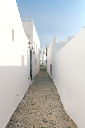 ideally: Traditional narrow street in the town Fira on the island of Santorini, Greece.