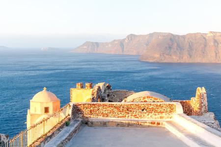 tera: View of the sea and island Nea Kameni from Cape Byzantine. Village Oia. Santorini. Stock Photo