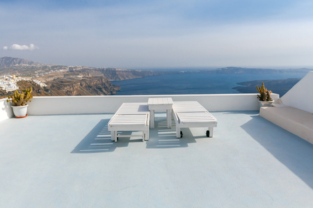 tera: View from the terrace in the town Fira. Picturesque landscape with the sea and the caldera.