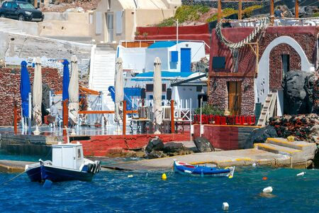 big waves: Big waves in water area the old harbor Oia village. Stock Photo