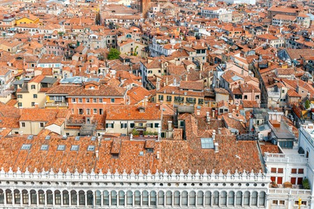 reference point: Aerial view from the bell tower on the red tiled roofs of Venice. Italy.