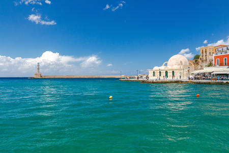 mol: View of the quay with lanterns and old lighthouse in the Venetian harbor. Crete. Greece.