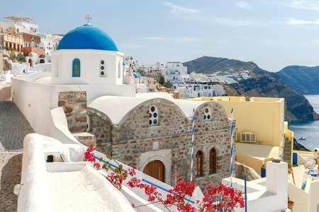 reference point: Blue dome on traditional Greek church in the village of Oia. Stock Photo