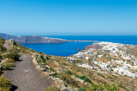 soothe: The picturesque aerial view from the mountains to the village Oia and the bay.