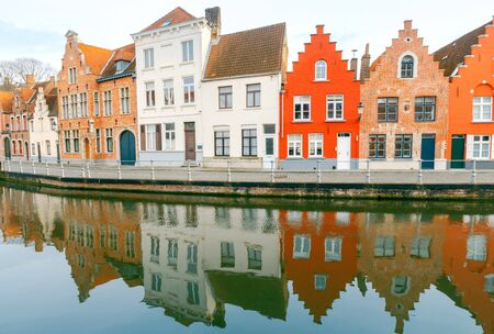 Traditional Belgian facades of houses on the canal Spiegel Rei in the city Bruges.