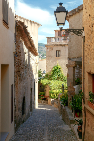 reference point: Traditional narrow street in the old fortress in Tossa de Mar
