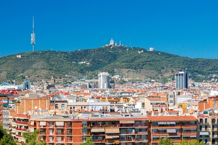 famous industries: Aerial view of the city and Mount Tibidabo. Barcelona. Spain.