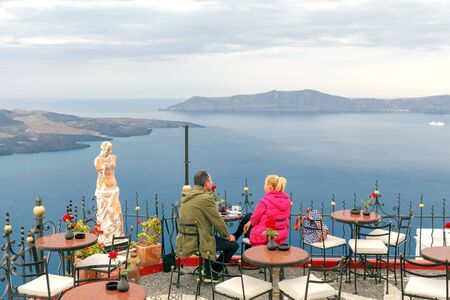 fira: Fira, Greece - May 1, 2016: Embankment in the town of Fira on the island of Santorini. The Greek islands are one of the most visited tourist destinations in Europe. Editorial