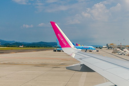 inexpensive: Bergamo, Italy - July 31, 2016: Wizz Air company aircraft at Bergamo airport. The company offers one of the Wizz Air inexpensive flight to Europe. The company flies to 29 countries.