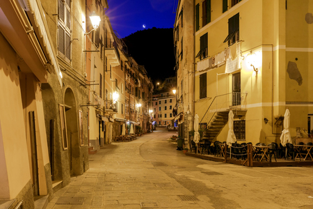 Old, narrow, medieval streets in the Italian village Vernazza. Cinque Terre National Park, Liguria, Italy.