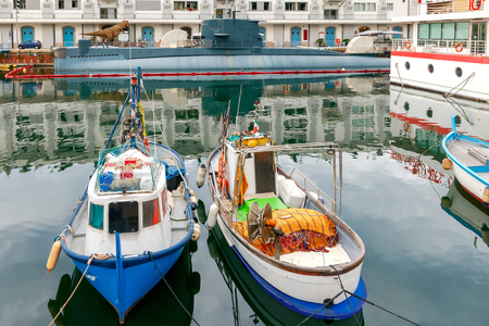 reference point: Fishing multi-colored boats in the old port of Genoa. Italy.