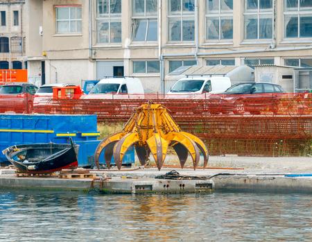 metal scrap: Crane grabber for the loading metal scrap. Stock Photo